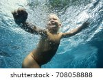 small baby learning to swim.... | Shutterstock . vector #708058888
