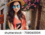 pretty brunette outdoors | Shutterstock . vector #708060004
