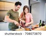cute joyful couple cooking... | Shutterstock . vector #708073870