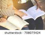 two teenagers sit reading books ... | Shutterstock . vector #708075424
