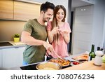 cute young couple cooking... | Shutterstock . vector #708076234