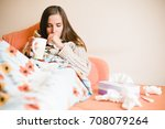 sick young woman coughing on... | Shutterstock . vector #708079264