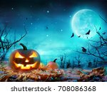 pumpkin glowing at moonlight in ... | Shutterstock . vector #708086368