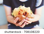 the girl is holding a big... | Shutterstock . vector #708108220