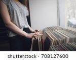 choosing retro vinyl records.... | Shutterstock . vector #708127600