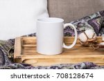 white mug on a wooden tray  the ... | Shutterstock . vector #708128674