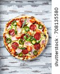 pizza with salami and ham   Shutterstock . vector #708135580
