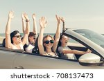 smiling friends driving car... | Shutterstock . vector #708137473