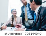 business analyst smiling while... | Shutterstock . vector #708144040