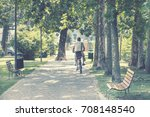 man riding a bike at park  old... | Shutterstock . vector #708148540