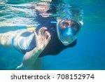 snorkel girl underwater shows... | Shutterstock . vector #708152974