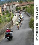 Small photo of FORNOLI, ITALY - AUGUST 13, 2017: Cycling is a massively popular sport in Italy. Here a race goes through the tiny village of Fornoli, in the Massa Carrara area, and many villages turn out to watch.