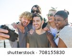 laughing friends making selfie... | Shutterstock . vector #708155830