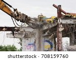 Small photo of Industrial dismantle, mechanical destruction. Dismantling of the building with the help of heavy hydraulic shears