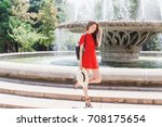 young stylish woman wearing red ... | Shutterstock . vector #708175654