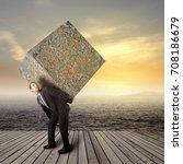 businessman carrying heavy... | Shutterstock . vector #708186679