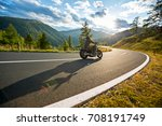 Motorcycle driver riding in Alpine highway, Nockalmstrasse, Austria, central Europe. - stock photo