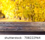 empty wooden table with autumn...   Shutterstock . vector #708222964