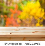 empty wooden table with autumn...   Shutterstock . vector #708222988