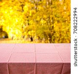 empty wooden table with autumn... | Shutterstock . vector #708222994