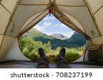 guy in trekking boots is in a... | Shutterstock . vector #708237199