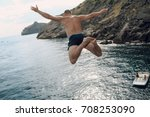 water jump from the rock | Shutterstock . vector #708253090