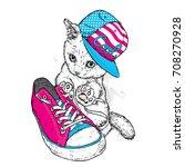 cute kitten in a cap and...   Shutterstock .eps vector #708270928
