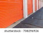 row of an orange metal doors of ... | Shutterstock . vector #708296926