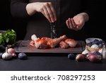 a female chef sprinkles fresh... | Shutterstock . vector #708297253