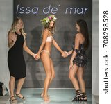 Small photo of MIAMI BEACH, FL - JULY 23, 2017: Designers Melissa Jasniy (L) and Marissa Eveland walk the runway wearing Issa de' mar 2018 Collection during Funkshion Swim Fashion Week at Funkshion Tent