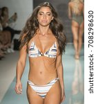 Small photo of MIAMI BEACH, FL - JULY 23, 2017: A model walks the runway wearing Issa de' mar 2018 Collection during Funkshion Swim Fashion Week at Funkshion Tent