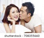 loving asian couple lying on... | Shutterstock . vector #708355660
