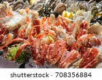 Small photo of Alaska King Crab Legs on ice,Buffet line