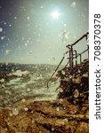 water splashing on a rocky...   Shutterstock . vector #708370378