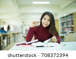 female student taking notes... | Shutterstock . vector #708372394