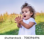 a child with curly hair plays... | Shutterstock . vector #708396496