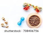 Stock photo large bowl of pet dog food with toys on white background top view mockup 708406756
