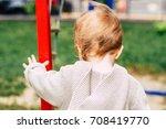 baby girl wearing knitted... | Shutterstock . vector #708419770