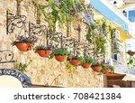 flower pots with plants hanging ... | Shutterstock . vector #708421384