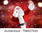 santa claus singing songs on...   Shutterstock . vector #708427420