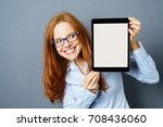 fun young woman holding up a... | Shutterstock . vector #708436060