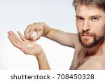 man with a beard looks into the ... | Shutterstock . vector #708450328