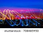light trail painting. background | Shutterstock . vector #708485950