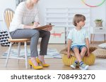 misbehaving boy sitting on a... | Shutterstock . vector #708493270