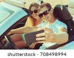young couple traveling by car | Shutterstock . vector #708498994