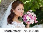 stunning young bride posing in... | Shutterstock . vector #708510208