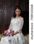 gorgeous brunette bride posing... | Shutterstock . vector #708510268