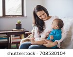 happy mother playing with her... | Shutterstock . vector #708530104