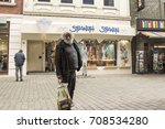 Small photo of GERMANY, Kamen, northern Westphalia. 30.08. 2017 - A shabby old man with a small affluence, in a good mood with shopping from the store