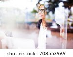 a beautiful smiling young... | Shutterstock . vector #708553969
